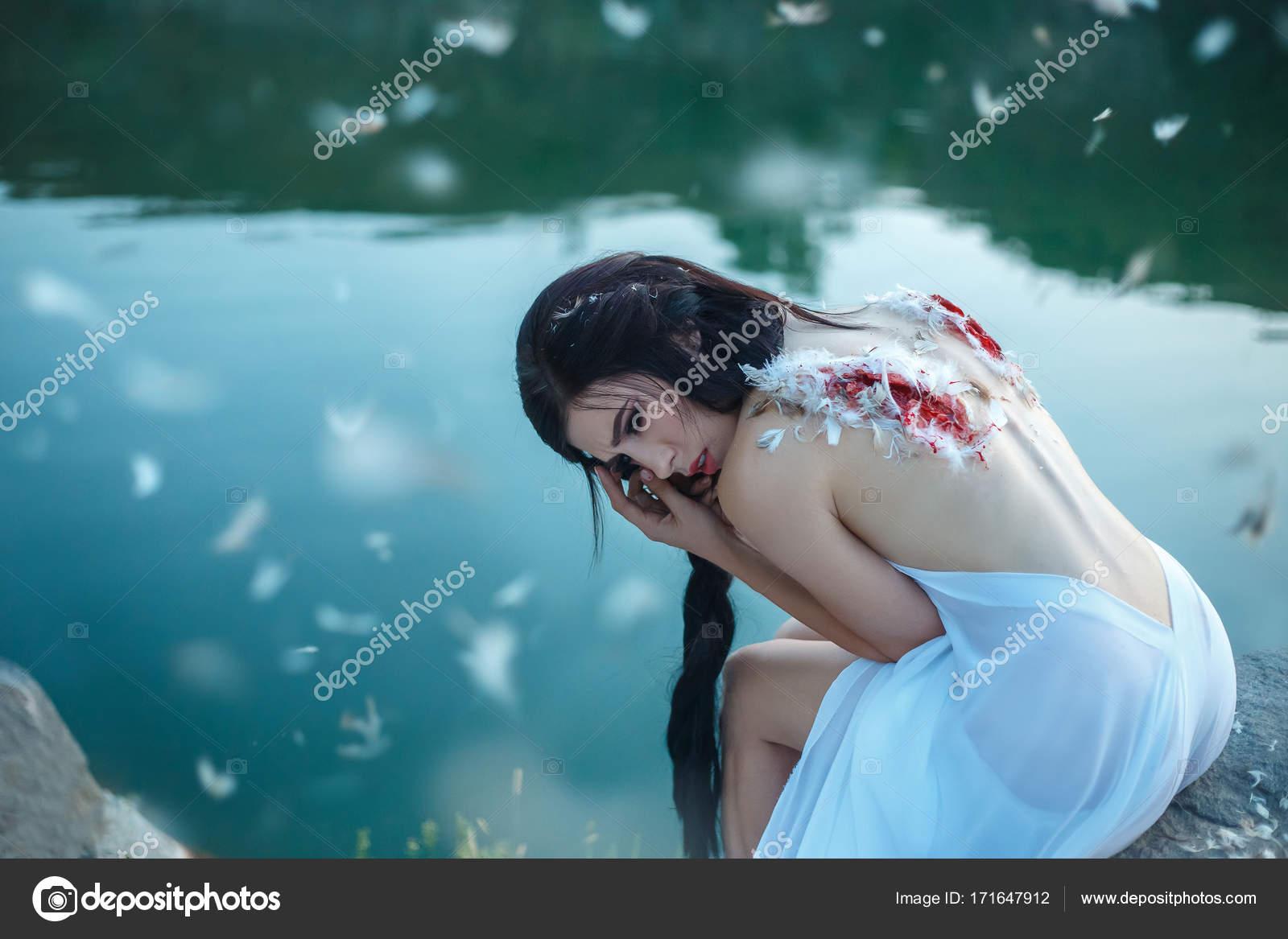 depositphotos_171647912-stock-photo-fallen-angel-a-girl-with.jpg